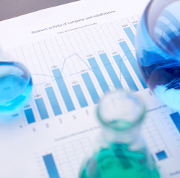 Test-tubes with blue liquids over business document