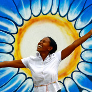 "Woman in a very happy mood in Dili beside a graffiti representing the sun. Today is World Mental Health Day. In his message to mark the Day, UN Secretary-General Ban Ki-moon said mental health is essential for personal well-being, family relationships, and an individual's ability to contribute to society. He called for mental health awareness to be integrated into all aspects of health and social policy, health-system planning, and general health care. ""Let us recognize that there can be no health without mental health,"" he said. UNMIT Photo/Martine Perret/ 10 0ctober 2008"